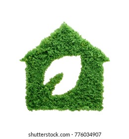 Nature is home concept. Grass growing in the shape of a house with a cut out leaf. Build sustainable homes and protect the environment.