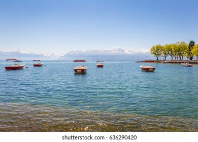 Nature, Lake Geneva with Red Boats, Lausanne, Switzerland with Mountains on the Background