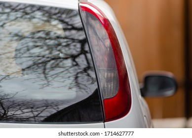 Nature landscape. Car in the woods. Trees reflections in the car rear windows.