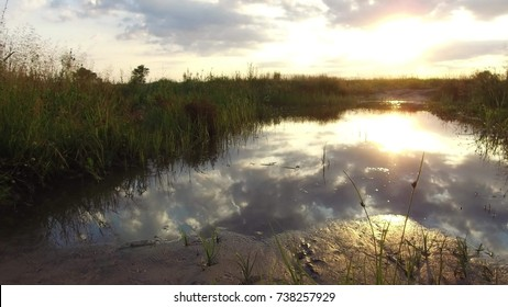 Nature landscape lake reflection of clouds in the water sunset sunlight