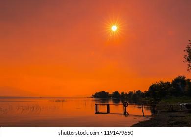 Nature landscape and lake. Sunset. Wooden pier. Magnificent view. Golyazi, Iznik, Bursa.
