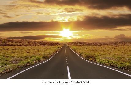 Nature landscape of sunset light above asphalt road.