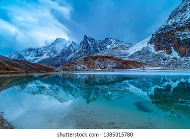 Nature landscape,Unique colored Milk lake (approx. 4300m altitude) with blue sky and sharp mountains around it in Daocheng Yading Nature Reserve, Sichuan, China