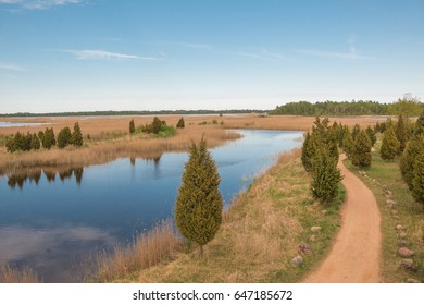 Nature of Latvia. View of the beautiful lake on a sunny spring day.