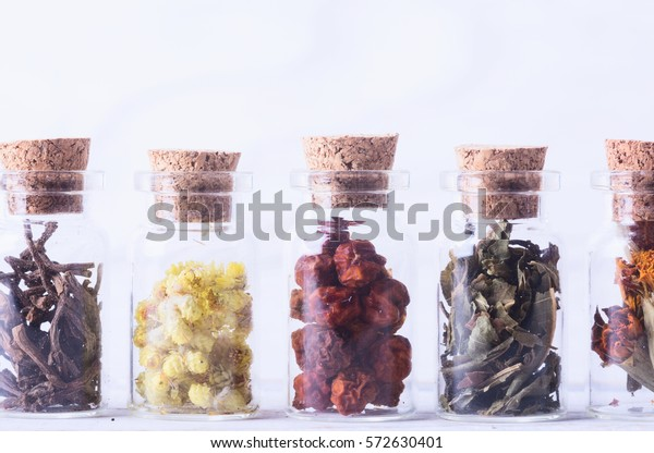 Nature medicine . Herbs in bottles on wooden background