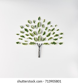 Nature Minimal Concept - Tree made of green leaves on white background. Flat Lay
