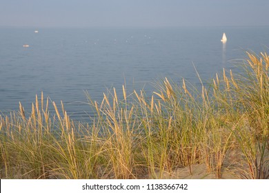 Nature of Neringa spit. Lithuania. Yacht and sea.