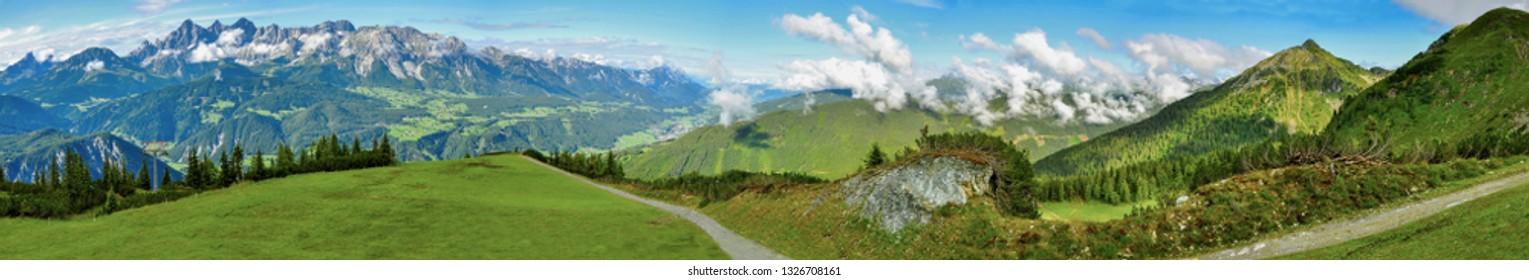 Nature panorama of Alps. Summer scenery of mountains near Switzerland. Green meadows and big peaks of Alps in behind.