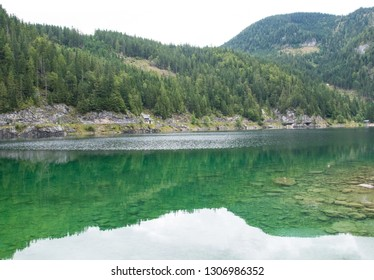Nature panorama landscape with river, and forest with reflections