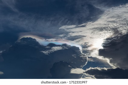 nature phenomenon iridescent pileus cloud or rainbow cloud in sky