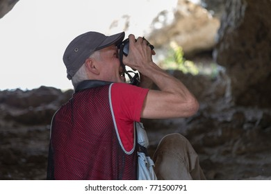 Nature photographer with digital camera. It is a portrait close-up.