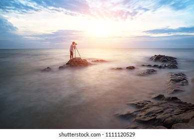 Nature photographer,Beautiful stone background on the beach at sunset in Pattaya, Thailand.