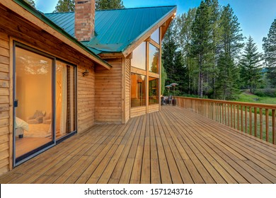 Nature with pine trees, mountains and beautiful chalet cider home exterior with bedroom interior view.
