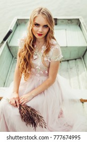 Nature portrait of a young blonde girl with long curly hair. Beauty, natural, nature concept