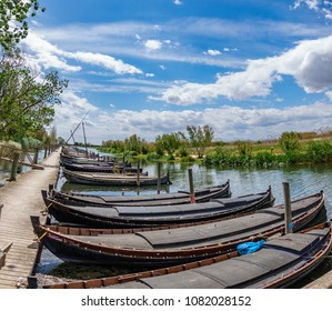 Nature reserve of Albufera with picturesque wooden fishing boats and pier in Catarroja, Valencia
