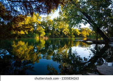 nature river Reflections of colorful leaves on tranquil trees along waters of Barton Springs in Austin , Texas - a river nature landscape relaxing under the shade of trees