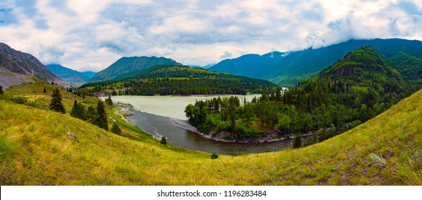 Nature of Russia. Altai region. The river Ursul flows into the Katun River. Sun rays from the cloud