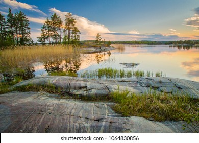Nature of Russia. The Republic of Karelia. Reflection of clouds in the water. Islands on the horizon. Wild nature. Calm on the lake. Karelia Ladoga Lake.