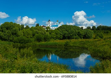 The Nature of Russia. Suzdal landscape with Vasilievsky monastery, dense trees and the river.