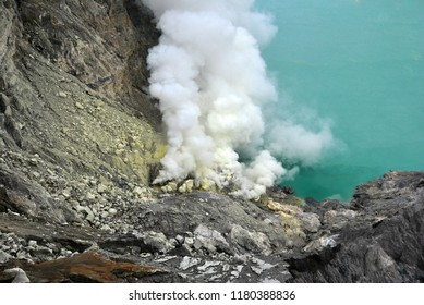 Nature scene of Kawah Ijen volcano and sulfur smoke at Sulfur mining Banyuwangi of East Java, Indonesia