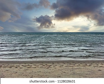 Nature Scenery of Sea Sand and Cloudy Sky