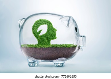 Nature is the seed of our being. Environmental awareness concept, with grass growing in the shape of a cut out leaf inside a man head, inside a transparent piggy bank.