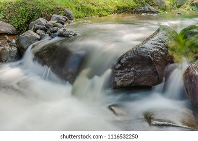 Nature small waterfall river, long exposure shot, Kaliurang, Yogyakarta, Indonesia. June 2018