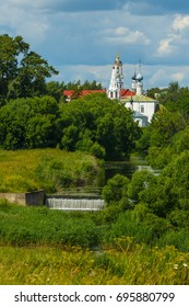 The Nature of Suzdal. The lower dam on the river Kamenka and Cosmas and Damian Church with bell tower (in the foreground).