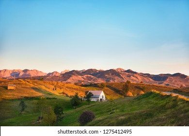 Nature view with houses in mountain slope with sky and mountains background, Durmitor on the way to Black Lake - Crno Lake, from Zhablyak