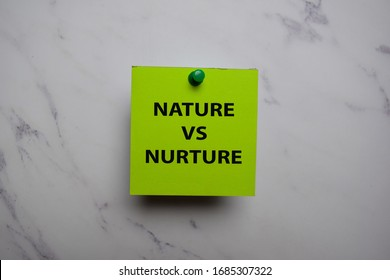 Nature Vs Nurture write on sticky note isolated on Office Desk