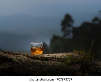 The nature whiskey On the rock of whiskey The cool whiskey  Whiskey with ice  Out side party