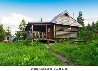 Nature wooden houses in a Carpathian mountains, Ukraine