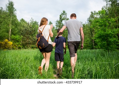Nature-loving family makes walk in the forest