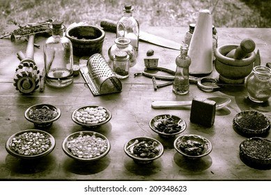 Nature's Pharmacy.  Vintage mortar and pestle surrounded by various herbs, ingredients and tonics.