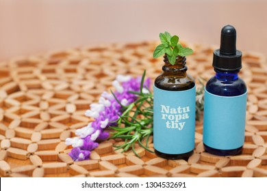 Naturopathic medicine concoctions in glass bottles with natural plants and herbs.