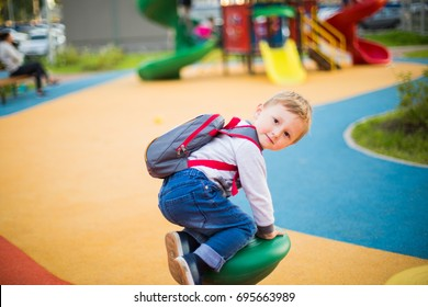 Naughty boy on the playground