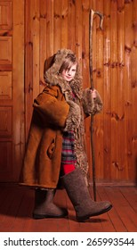 Naughty cowgirl in my mother's fur coat, boots and a staff Farm