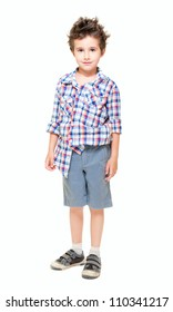 Naughty  little boy in shorts and shirt isolated on white