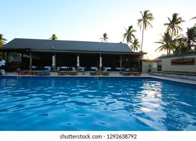 Naukacuvu, Fiji - August, 2017. Sunset in a swimming pool of a resort (Paradise Cove Resort) on the island of Naukacuvu, Yasawa Islands, Fiji