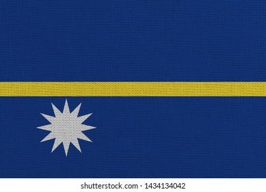 Nauru fabric flag. Patriotic background. National flag of Nauru
