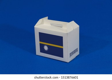Nauru flag on white box with barcode and the color of nation flag on blue background. The concept of export trading from Nauru, paper packaging for put products.