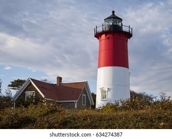 Nauset Light, a landmark red and white lighthouse at Nauset Light Beach in Eastham MA on Cape Cod Massachusetts USA