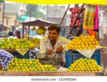 Nautanwa, India - June 14 2018: A middle-aged Indian fruit seller selling tropical fruits