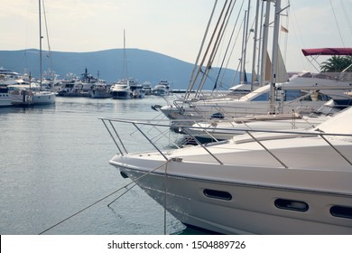 Nautical background with modern design luxury yachts moored in quiet marina