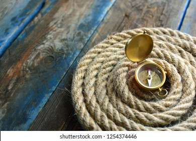 Nautical background. Sailing rope with a compass closeup.