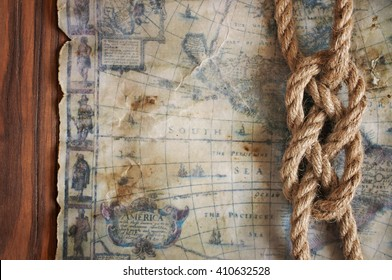 Nautical background with sailor knot and old map close-up