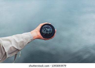 Nautical compass in female's hand
