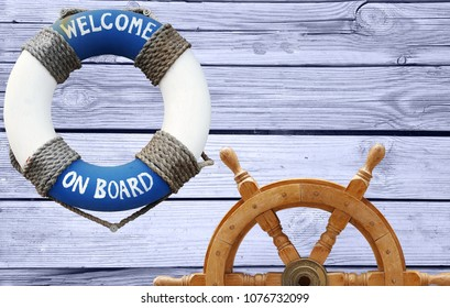Nautical concept with lifebuoy and ship steering wheel on olld vintage wooden background