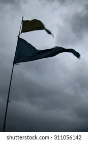 Nautical Flags and Dark Clouds