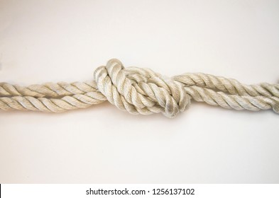 nautical knots tied by the rope of a rope on white background